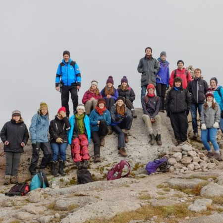 Photograph of students on a mountain top