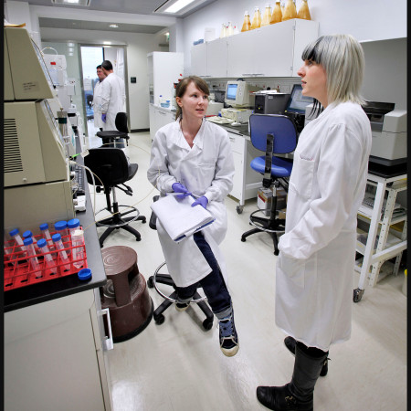 two students talk in a lab