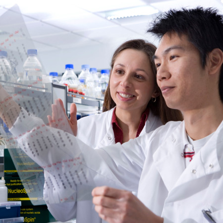 Two students in a biology lab