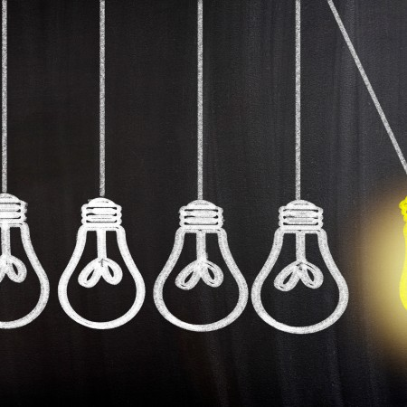 Idea Bulb Concept Drawing on Blackboard