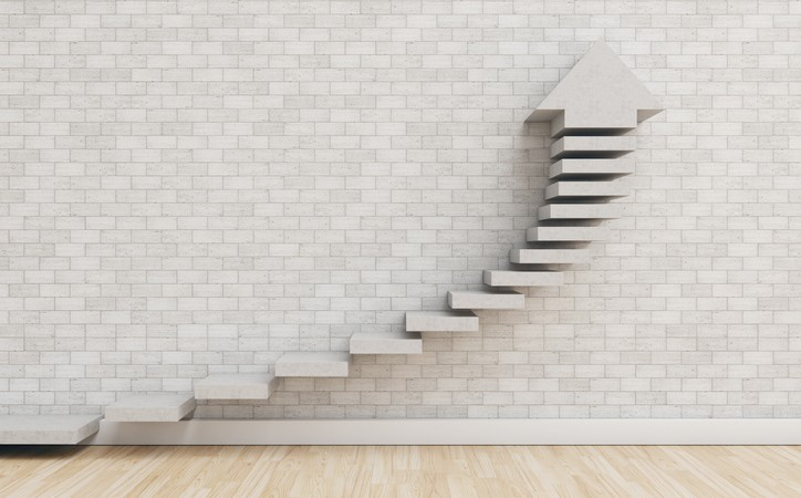 wood steps on marble wall with up arrow