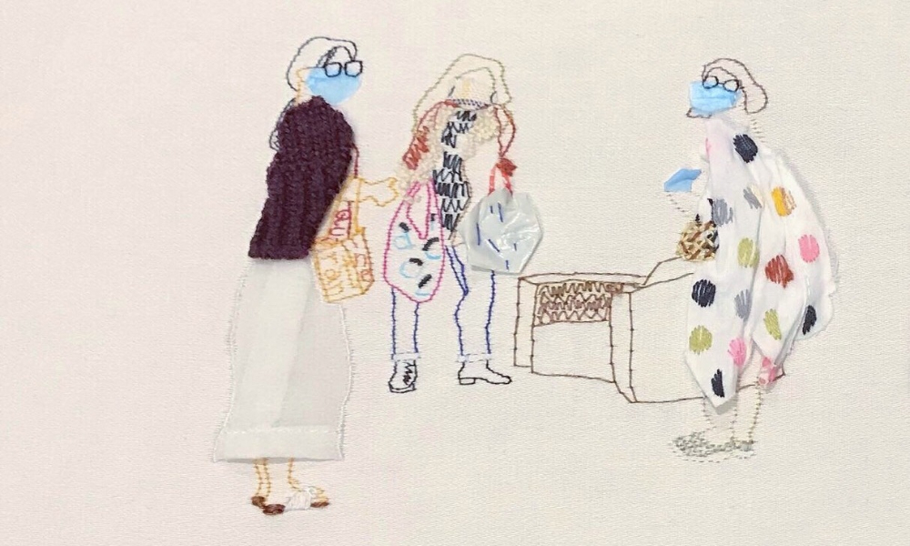 An illustration created with hand embroidery of three women wearing masks carrying shopping bags.