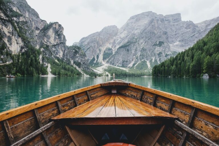 Close up of canoe in river surrounded by mountains