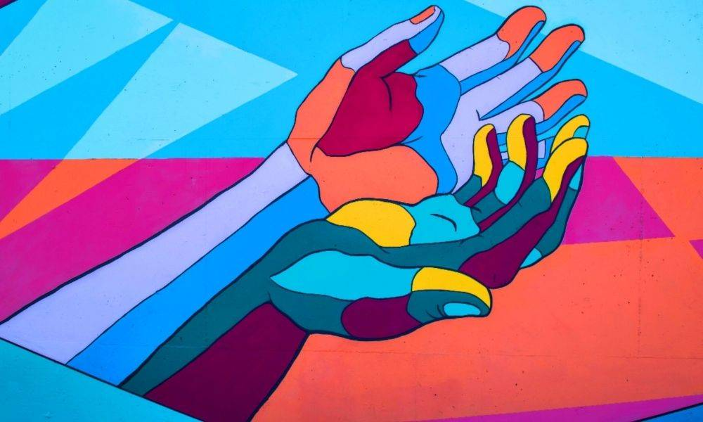 colourful illustration of one hand holding another hand.