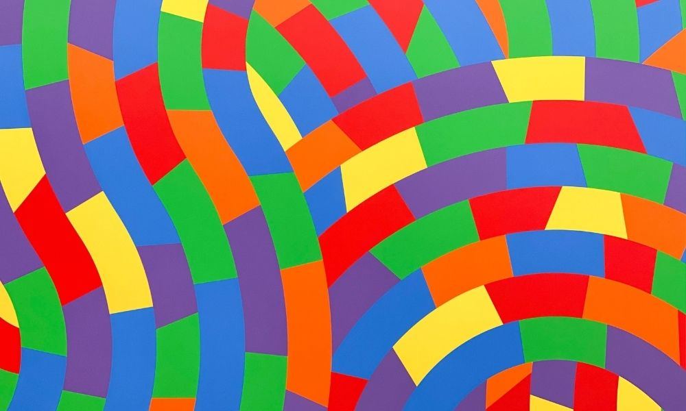 picture of geometric shapes with the colours of the rainbow