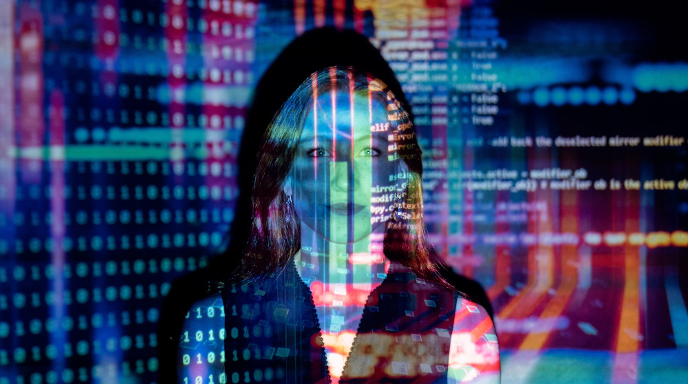 Coding images reflecting on silhouette of a woman